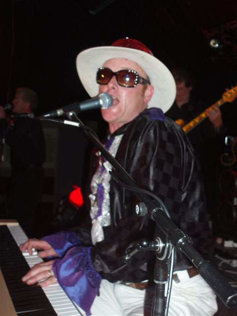 Mike Mckendry performing in an Elton John Tribute Show.